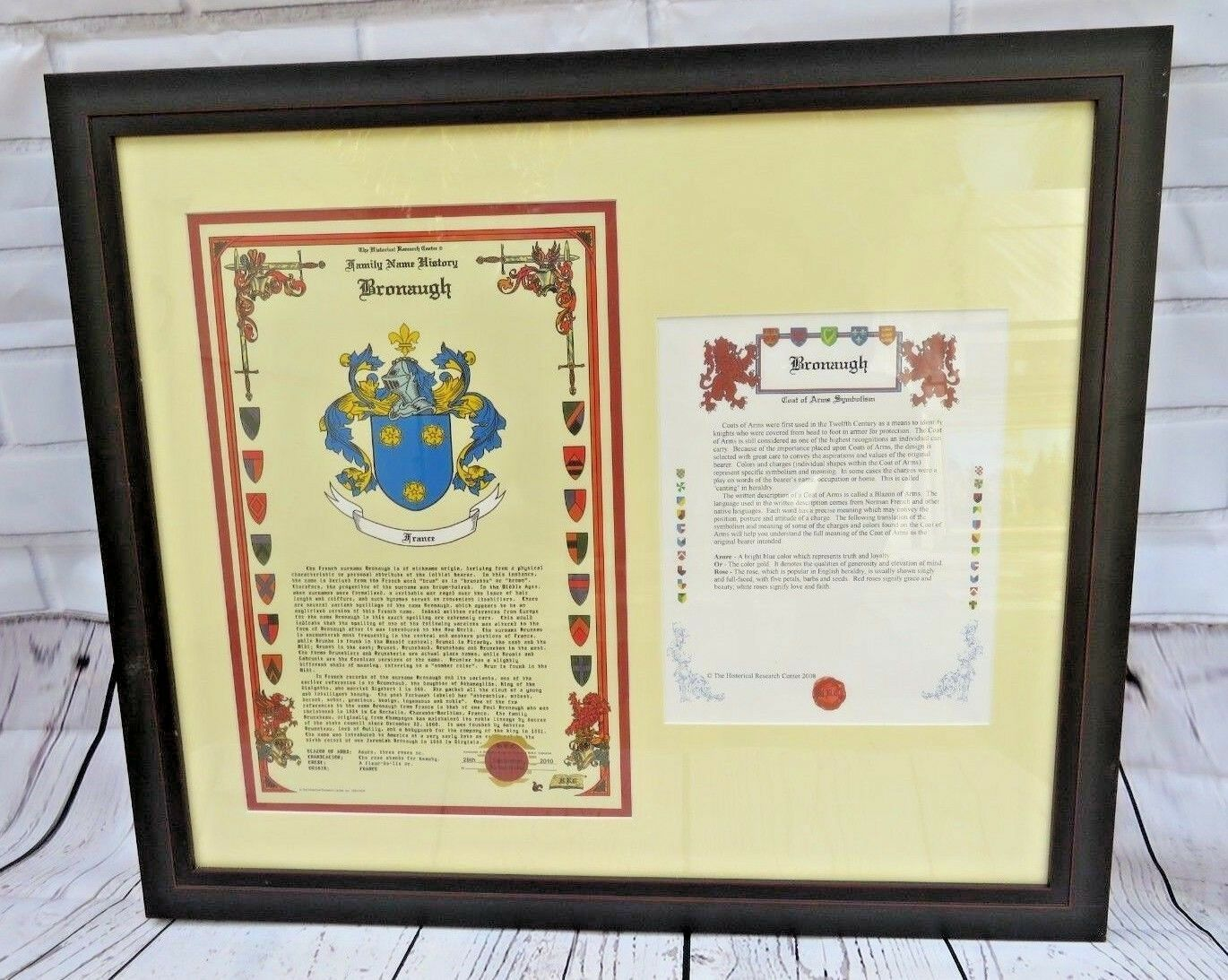 Primary image for BRONAUGH family name history CREST COAT OF ARMS HISTORICAL RESEARCH CENTER FRAME