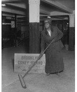 Woman sweeps floor in Coney Island New York subway station 1917 Photo Print - $8.81+