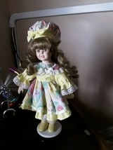 Early blosson  porcelain doll 14 inches  with long curls with tag - $29.85