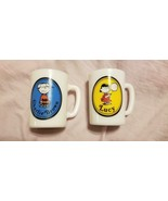 VINTAGE LOT OF (2) PEANUTS AVON MILK GLASS MUGS CHARLIE BROWN AND LUCY - $50.00