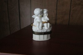 ceramic trinket box w/love angels sitting on top, open to find 'x' & 'o'... - $8.60
