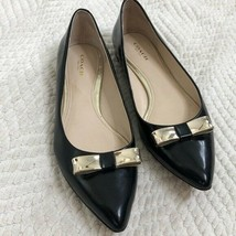 Coach Black Pointed Toe Gold Bow Flats, 7.5 - $75.00