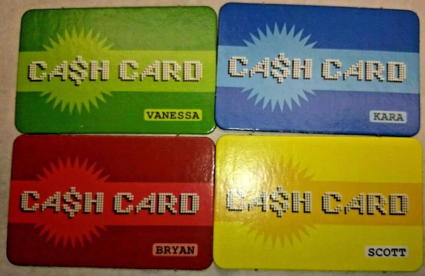 Primary image for Mall Madness Milton Bradley 2004 Set of 4 Cash Cards Red Yellow Green Blue