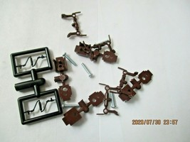 Micro-Trains Stock #00122301 True -Scale Brown Long Shank Coupler  (1301-B) (N) image 1