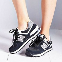 New Balance Women's W574 Classic Fashion Sneaker, Black/White, US Women 6 - $54.99