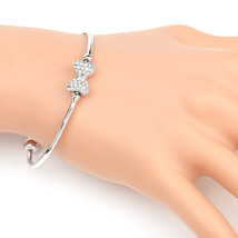 UE-Trendy Silver Tone Designer Bangle Bracelet With Swarovski Style Crystal Bow  - $18.99