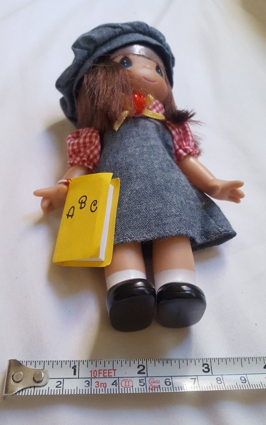 "7"" Precious Moments Vinyl Doll wearing apple hat holding ABC book pre-owned cute"