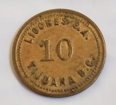 """10 Licores Tijuana B.C.  5/8"""" brass token - $9.95"""