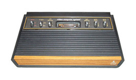 Atari 2600 Launch Edition Woodgrain Console with 2 joysticks and 2 paddles - $70.00