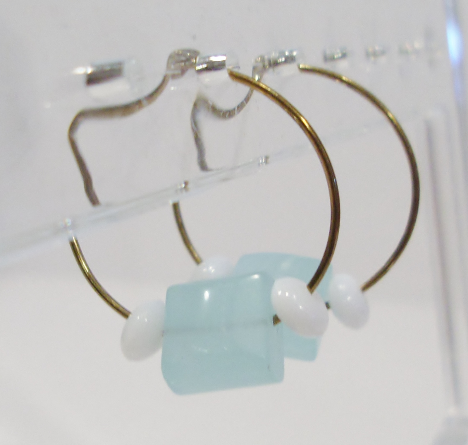handmade gold hoop earrings with blue and white beads