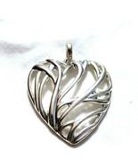 C77 Silver tone metal heart pendant openwork - $9.85