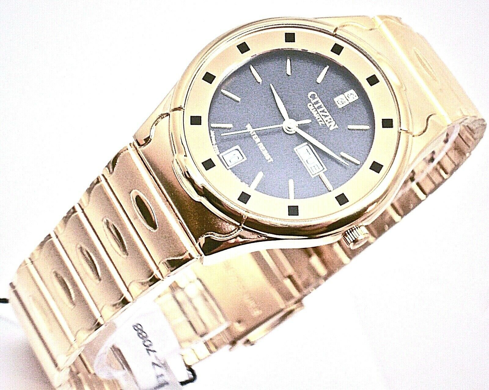 Primary image for New Quartz citizen mens watch gold tone black dial day & date .