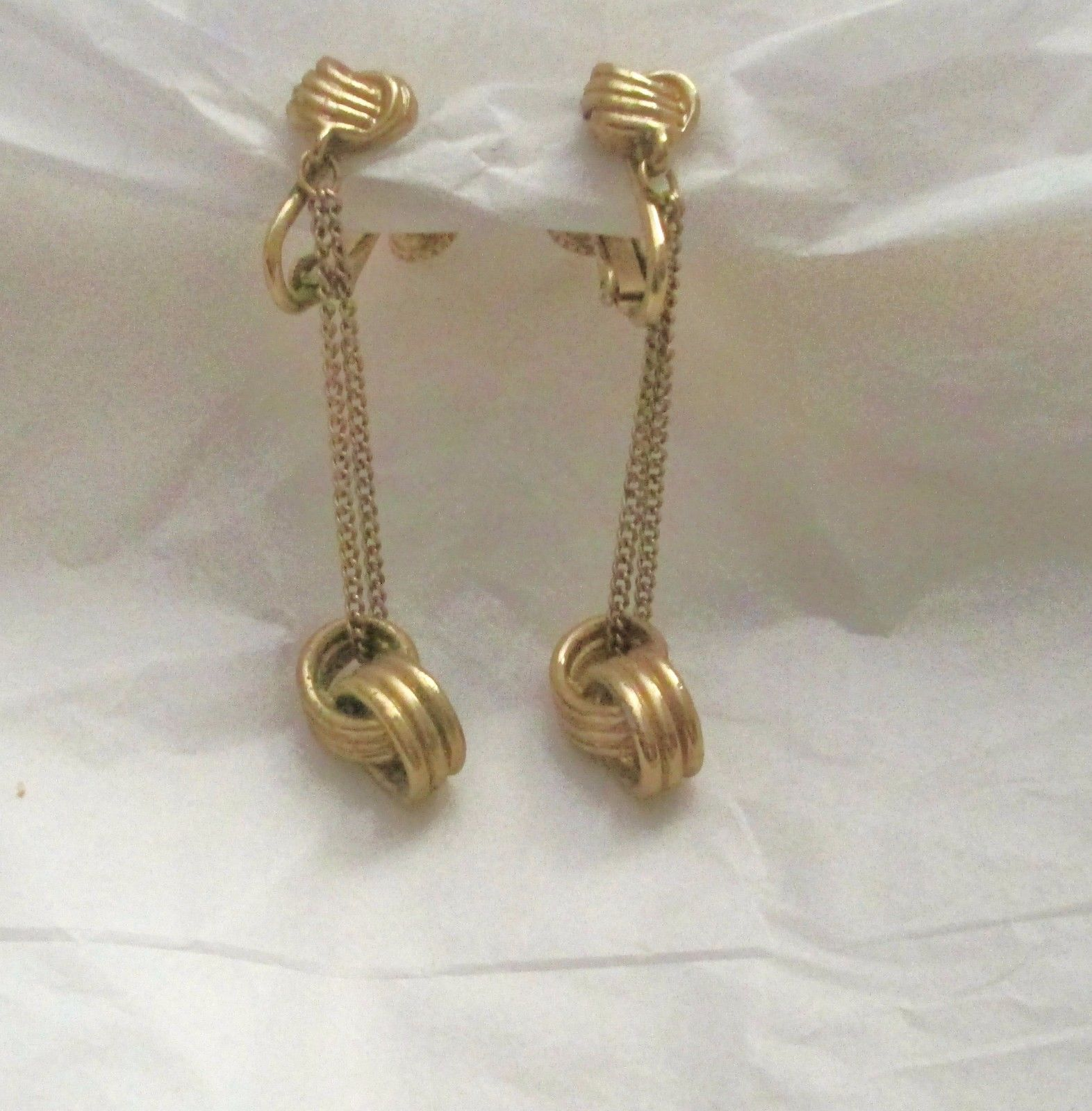 "Primary image for Vintage Vendome H-A  dangle gold tone knot screw back clip 2"" earrings marked"