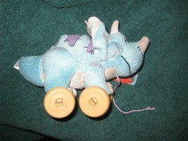 Disney Store Trixie Triceratops Pull Toy.  Brand New. Very Cute. 9 inches long. - $18.00
