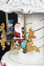 Elements Porcelain Santa & Elves Holiday Music Box Carousel Painted Jing... - $23.71