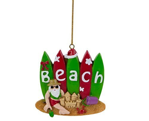 Santa with Surfboards and Sandcastle on the Beach Ornament