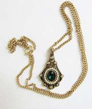 Avon necklace pendant faux emerad surrounded by faux pearls goldtone setting - $6.50