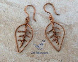 Handmade copper earrings: leaf with coiled veins - $20.00