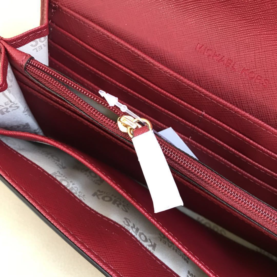 c8d4cb98d127 NWT Michael Kors Jet Set Travel Saffiano Leather PVC Carryall Flap Wallet  Cherry