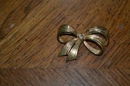 Vintage Avon gold tone bow brooch with rhinestones. - $4.99