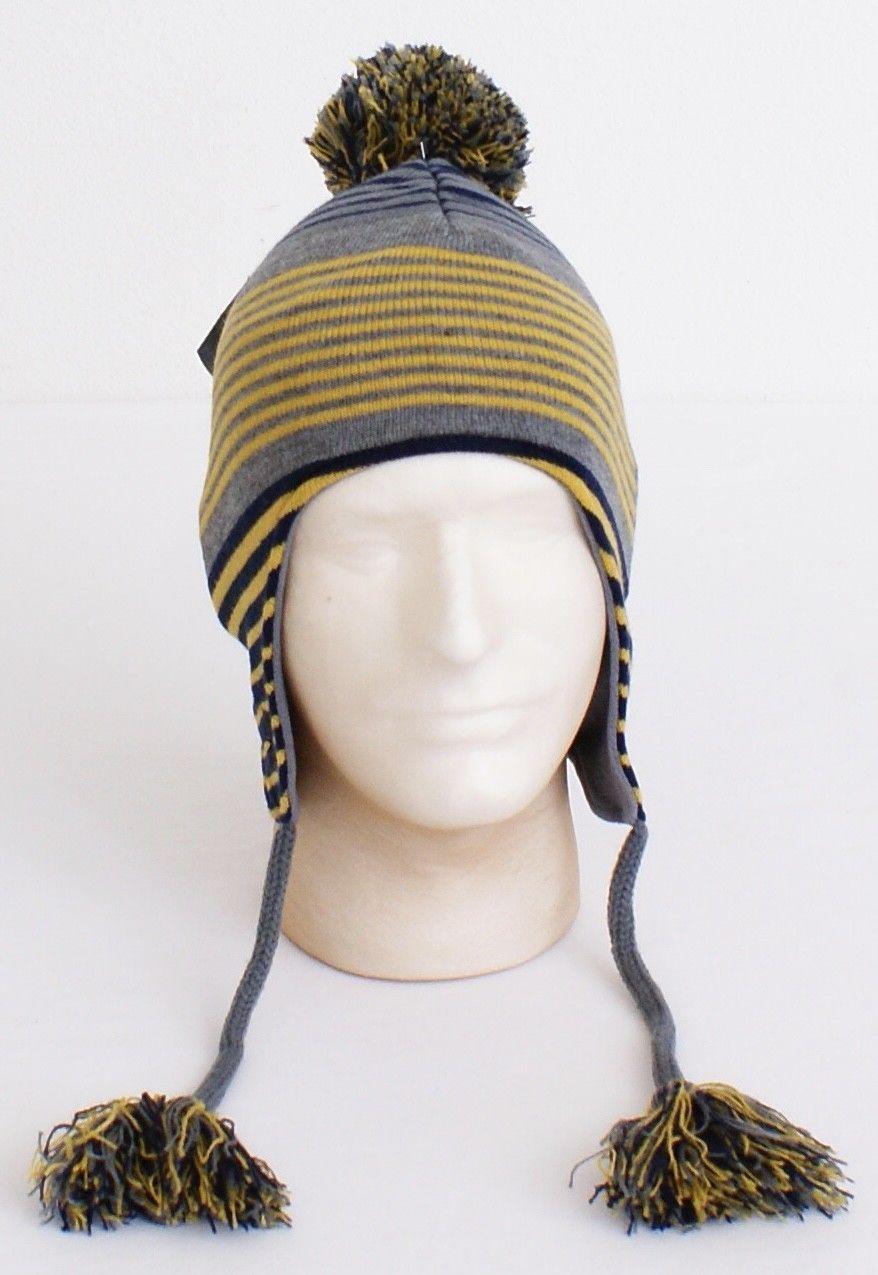 99e415fec20 57. 57. Previous. Under Armour Collegiate Notre Dame Knit Earflap Tassel  Beanie Men s One Size NWT