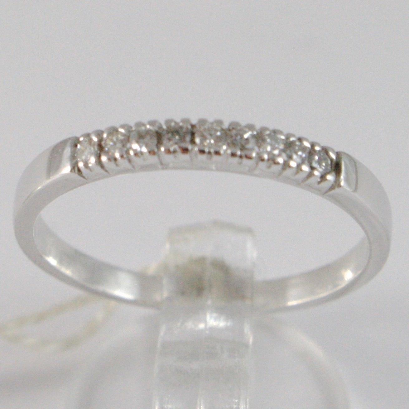 BAGUE EN OR BLANC 750 18K, VERETTA 9 DIAMANTS CARAT EN TOUT 0.06, TIGE CARRÉ