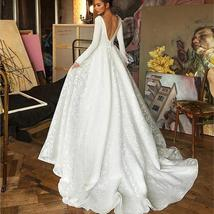 Booma Lace Long Sleeve V-neck Backless Satin Wedding Gown Plus Sizes image 2