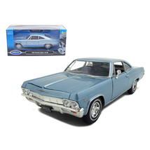 1965 Chevrolet Impala SS 396 Light Blue 1/24 Diecast Model Car by Welly ... - $29.91