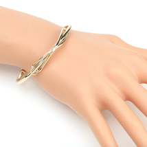 UE- Trendy Gold Tone Designer Bangle Bracelet With Contemporary Infinity... - $13.99