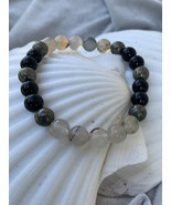 Emergence--Stones of blossoming, breaking barriers, and support - $20.00