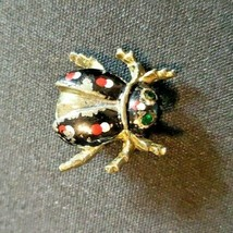 Vintage BUG/INSECT goldtone Brooch Pin (green rhinestone eyes/black & re... - $9.50