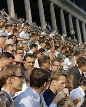 President John F. Kennedy in crowd at Harvard-Columbia football game Pho... - $8.81