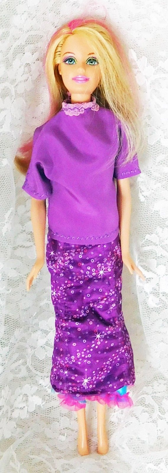 "Primary image for 2010 Mattel Barbie 11 1/2"" doll with Changing Skirt Goes Up and Down"