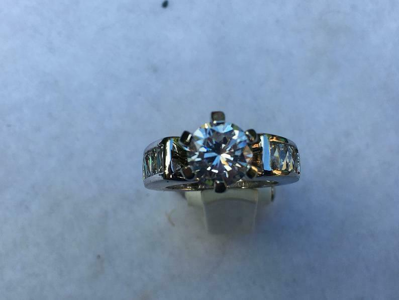 Primary image for Solitaire Simulated Diamond Set In Sterling Silver Ring, Baguette Side Accents 5