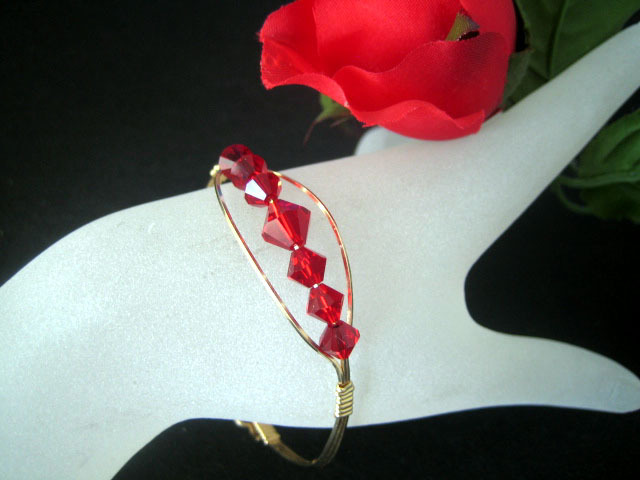 Gold and red crystal bracelet