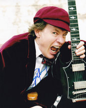 Angus Young In-Person Authentic Autographed Photo Coa AC/DC Sha #12606 - $165.00