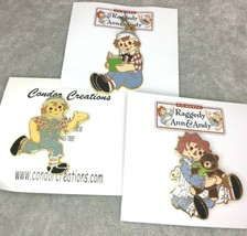 Raggedy Ann Hugging Bear Pin Reading Charm Pendant Running Andy Collector - $9.99