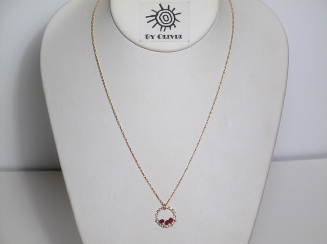 Gold Ruby Circle necklace