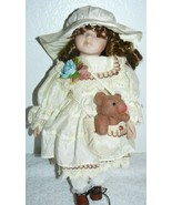 """Porcelain Collectible cloth body Doll 12"""" carrying a brown bear in a bag - $15.18"""