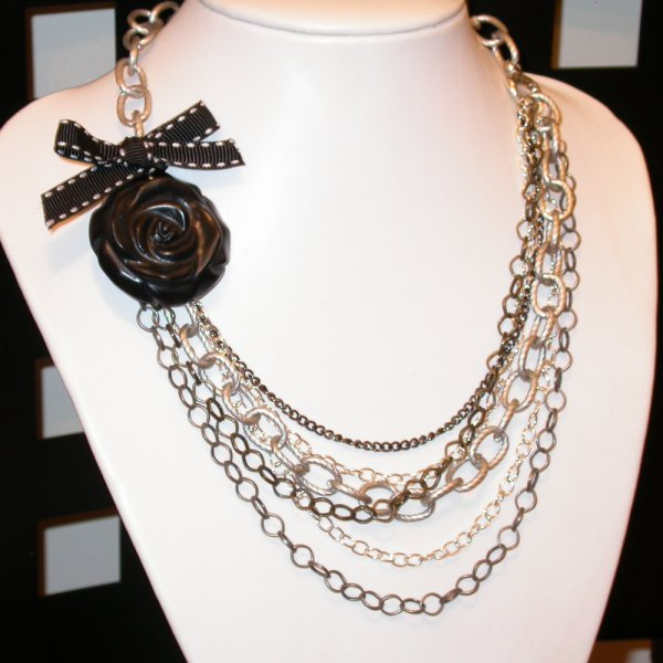 Chained!   Designer Necklace chained to hand carved ROSE.