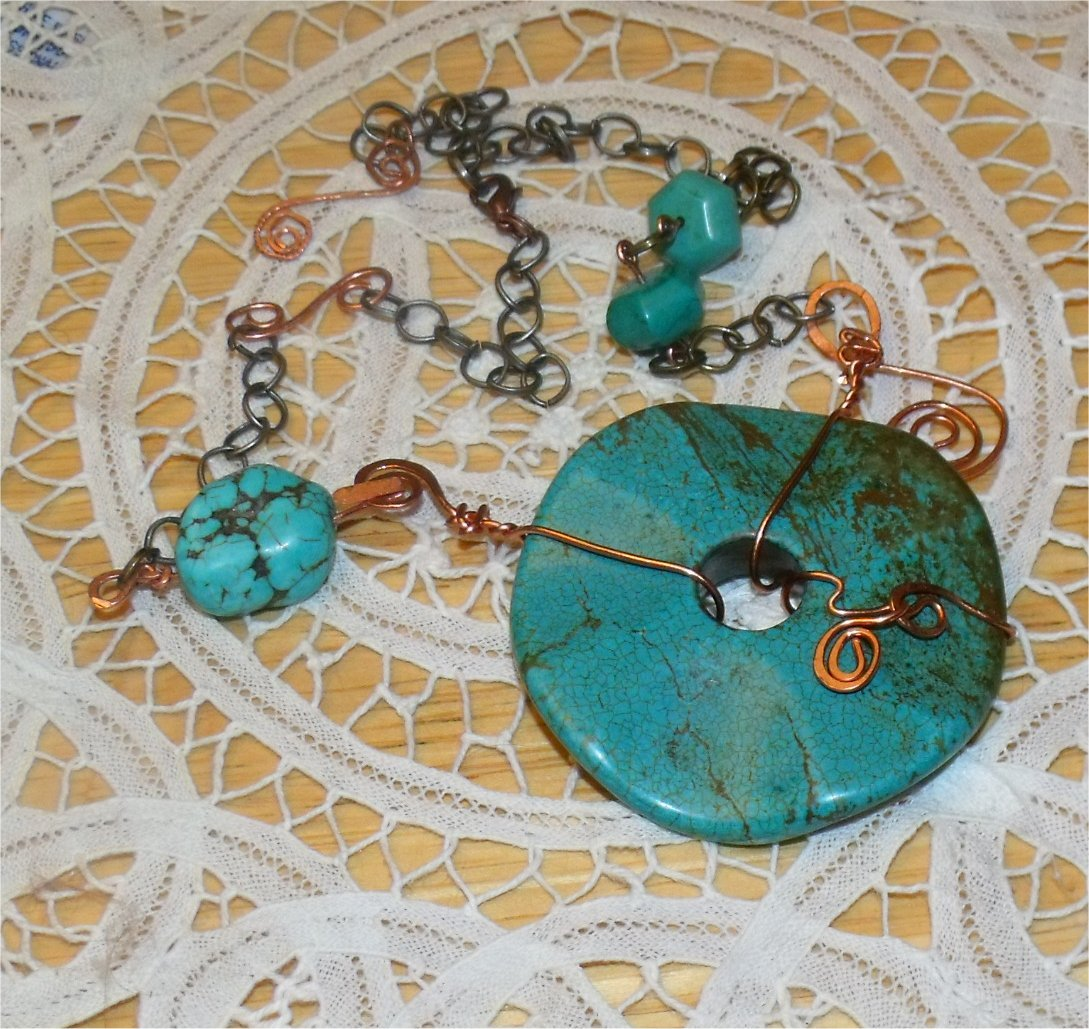 Large Turquoise donut with forged copper necklace- Introduct