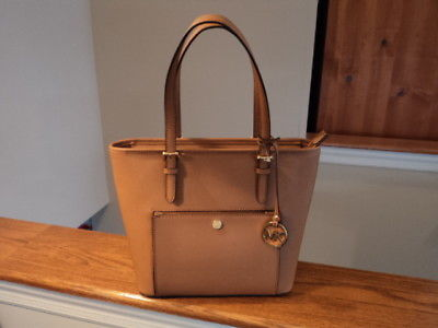 5cac288d9fba 1. 1. Previous. Authentic Michael Kors Jet Set Medium Snap Pocket Tote  Acorn Brown Leather NWT · Authentic Michael ...