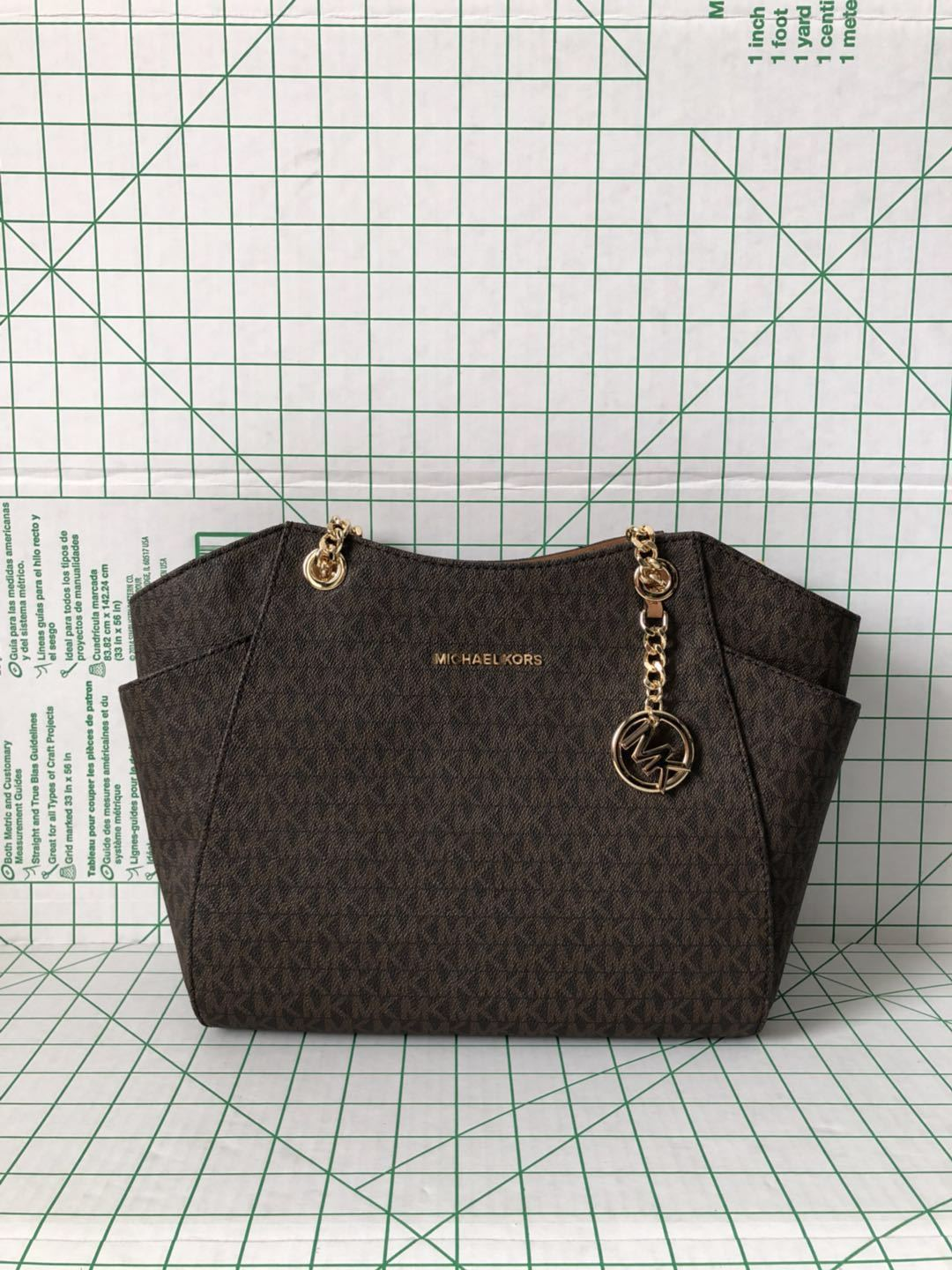 9eb378a6ffd7 57. 57. Previous. Michael Kors Jet Set Travel Large Signature Shoulder Bag  Brown PVC Chain Tote