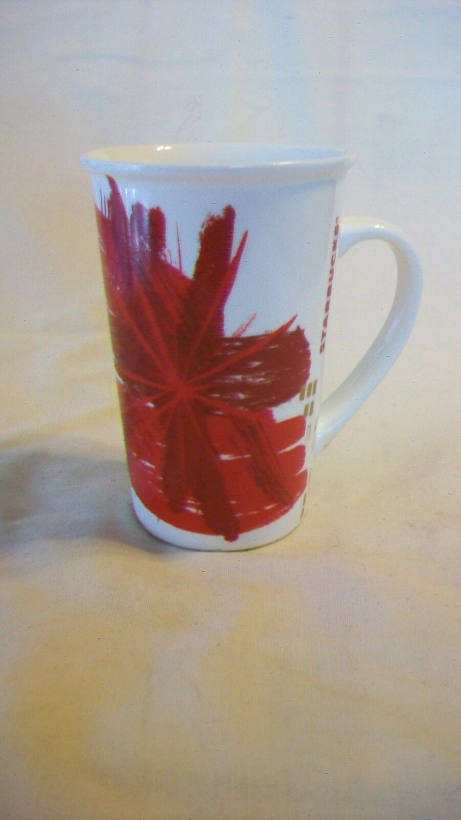 Primary image for Pair of 2014 Starbucks Red Splash Christmas Ceramic Coffee Mugs, holds 12 ounces