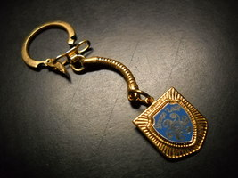 Geauga Lake Key Chain Gold Colored Fob with Blue Gold Shield Logo Amusement Park - $8.99