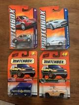 NEW NOS MATCHBOX #48 HUMMER1997, Ambulance, Ford Transit, Aston Martin DBS - $17.95