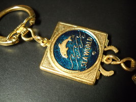 Sea World Key Chain Valet Style Gold Colored Metal with Blue and Gold Features - $7.99