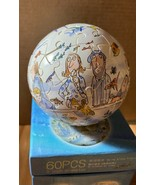 "Jimmy Liao 60pcs globe puzzle - Swing Alone Freely 幾米 自游自在 3"" diameter - $11.99"