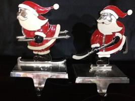 VINTAGE CAST IRON CHROME SANTA CLAUS ON SKII CHRISTMAS STOCKING HANGERS ... - $68.31