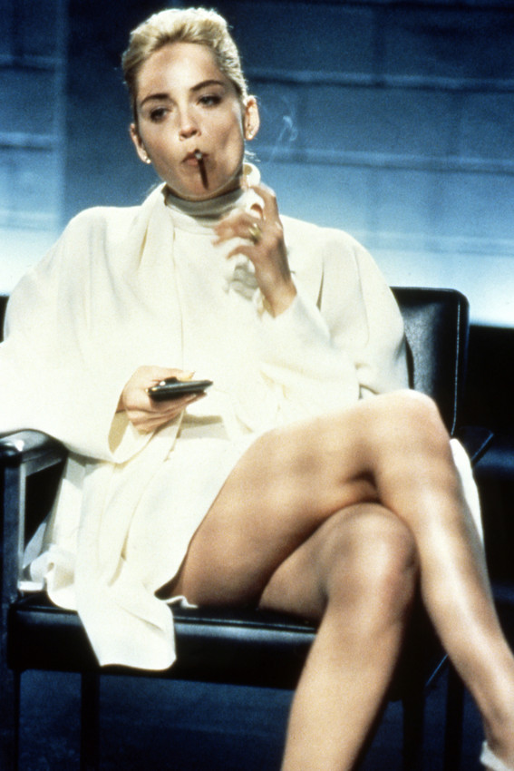 Sharon Stone in Basic Instinct classic pose legs crossed seated on chair 18x24 P - $23.99